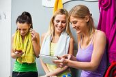 pic of training room  - Happy girls in locker room after fitness training - JPG