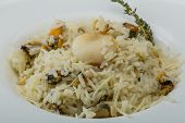 image of cuttlefish  - Risotto with mussels and cuttlefish served fresh thyme
