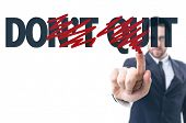 picture of quit  - Business man pointing the text - JPG
