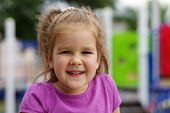 image of little young child children girl toddler  - Portrait a little girl on playground - JPG