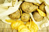 foto of potato chips  - Natural potato chips in a package and potatoes in the bag - JPG
