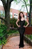 foto of evening gown  - Beautiful young attractive woman modeling her evening gown - JPG