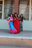 image of gypsy  - Three gypsy women posing in traditional outfits - JPG
