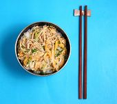 image of rice noodles  - Vietnamese vermicelli chicken and rice noodles soup pho on a blue background - JPG