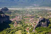 stock photo of red roof  - Aerial view of traditional greek Kalambaka town with red roofs from Meteora cliffs in Greece - JPG