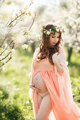 stock photo of night-blooming  - Young beautiful pregnant woman - JPG