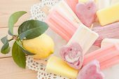 stock photo of popsicle  - Variety of frozen fruit popsicles on vintage plate - JPG