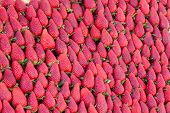 stock photo of stall  - Beautiful red strawberries arranged in a pyramid on a market stall - JPG