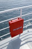 picture of firehose  - red fire hos box on the banister of a passenger ship - JPG