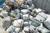 image of landfills  - rusted old abandoned gas counters in waste landfill - JPG