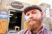 foto of facial piercings  - Portrait Of Hipster Barber Standing Outside Shop - JPG