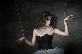 picture of gothic hair  - uncombed sensual woman with gothic puppet costume uncombed hair and clown make - JPG