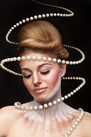 picture of surrealism  - Surreal art concept of girl with pearls arround her - JPG