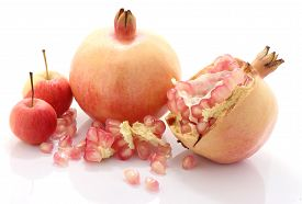 stock photo of pomegranate  - Pomegranate fruit and apple is eaten as a sweet or sour and sweet pomegranate is a fruit that have health benefits - JPG